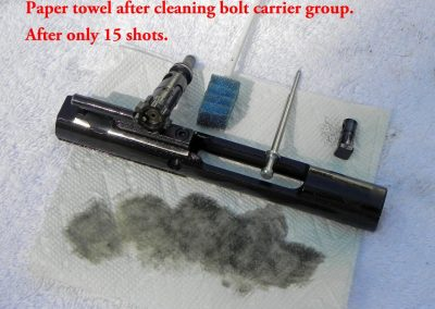 Paper towel after cleaning bolt carrier group after 15 shots. Paper towel is very dirty.