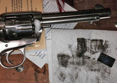 Revolver with used GunSponge on paper towel.